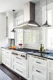 kitchen hood between hanging light pendants