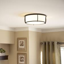 a flush mount light with metal and glass shade