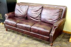 comfortable leather couch is 7 x 41 deep x 38 tall and appears