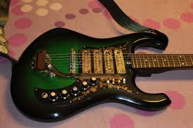 late 60s kimberly 4 pickup greenburst guitar and kawai greenburst i bought my first kimberly in the 90s and simply fell in love it s exaggerated horns the color and the four pickups i m all about any guitar