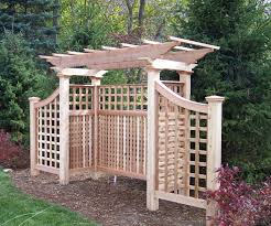 a pergola adds structure to the backyard garden