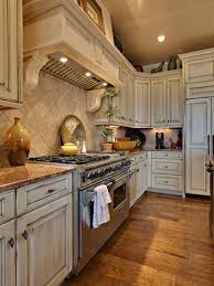 distressed white kitchen cabinets - for Paige...looks great with the marble  too