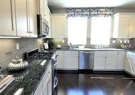 prodigous white cabinets dark grey countertops q4045153 white cabinets black countertop grey backsplash