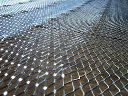 metal lath. the picture of diamond metal lath with dimpled shapes in a wooden surface.