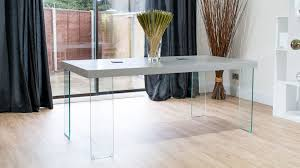 modern grey dining table with glass legs