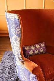 i love two diffe fabrics on one chair also love the super high back and tacks on this one