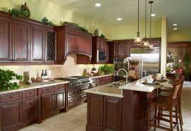 this high end kitchen is impressive from floor to ceiling obviously the first thing that catches your eye is the massive amount of cherry cabinetry