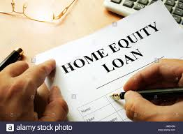 doent with name home equity loan on a desk