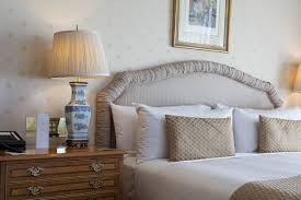 a bed with pillows on it get better sleep tonight with blue light blocking glasses