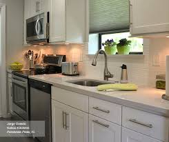 white shaker cabinets. white sedona shaker style cabinets in a galley kitchen