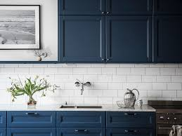 High Contrast Slate Blue Cabinets With White Subway Tile Backsplash