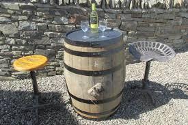 oak barrel bar table and 2 seats cast iron tractor seats
