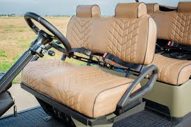 green brown six seater golf cart full