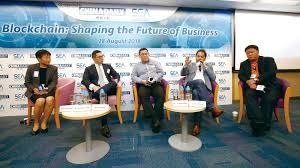 china daily asia leadership roundtable speaker phang yew kiat second right vice chairman and ceo of chong sing holdings fintech group says blockchain