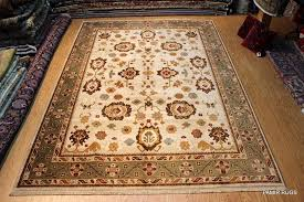 fine quality 9 x 12 wool area rug beige background