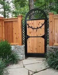 custom garden gate in iron and cedar