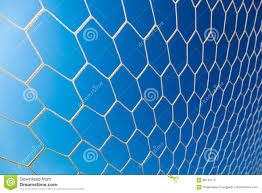 Wit Voetbal Of Voetbaldoel Netto Tegen Duidelijke Blauwe Hemel Stock