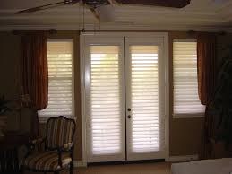 french doors with curtains. Hunter Douglas Silhouette Shades On French Doors Combined With Drapery Treatments Curtains