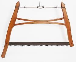 log cutting tools. vintage antique rustic primitive wood buck saw crosscut farm logging tool log cutting tools