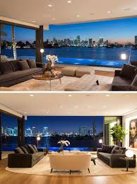 Image Interiors In The Living Room The Sliding Glass Doors Can Be Opened Completely So That The Living Room Has An Uninterrupted View Of Downtown Miami Lumens Lighting New Modern Waterfront Home Arrives In Miami Contemporist