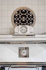 exterior exhaust fan kitchen. the round vent above stove, with its decorative grate, is a range hood vent. an inline fan inside wall vents to exterior, and works as well exterior exhaust kitchen