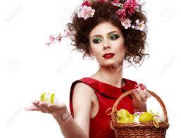 イースターの女性春ファッション髪型の女の子色とりどりの花で美しい