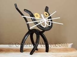 a cat made of horseshoes on horseshoe wall art star with horseshoe decor for sale