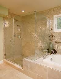 boston commercial bathroom with transitional vanity lights and tub surround glass shower