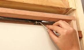 how to adjust a sliding door man attaching the rollers to hang the sliding door adjust