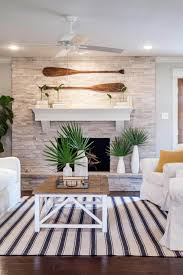 beach home interior design. Fine Interior 14 Palms In Front Of A Cozy Fireplace To Beach Home Interior Design O