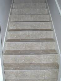 not sure how i feel about tiled stairs but i know i the carpet
