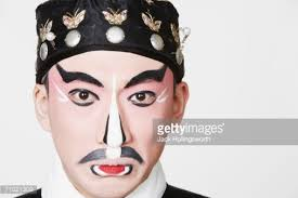 portrait of a male chinese opera performer making a face
