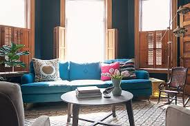 black walls teal sofa moroccan rug making it lovely