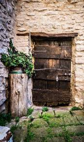 old door in small village may be an ugly door but it makes a beautiful photo