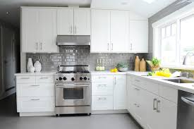 white kitchen with grey subway tiles transitional