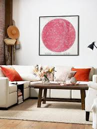 small space living room furniture sectional with pink astrological artwork and brick wall on thou