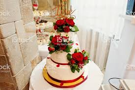 Closeup Photo Of A Big White And Red Wedding Cake Decorated With