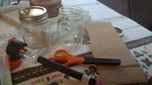 to start the project paint your mason jar the mason jar will be the solar light cover i painted mine with glitter so it shimmers at night