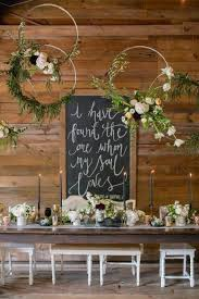 these wreaths are made out of small wooden circles topped with fresh fls and hung with ribbon they may be simple but they definitely stand out