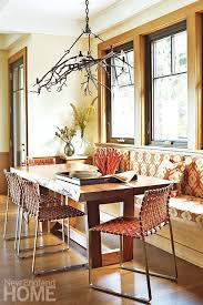 the breakfast area sports a live edge table from dennis miller and a branch chandelier from paul ferrante