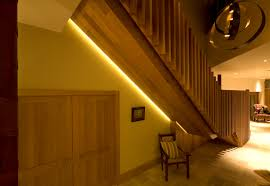clever lighting floats this massive oak staircase off the wall