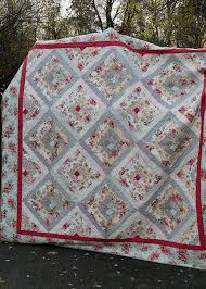 Potting Shed Quilt & The Potting Shed Quilt (affiliate link*) is a large log cabin quilt. It  finishes to 95? x 95?, which is nearly big enough for a king size bed. Adamdwight.com