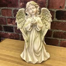 standing angel with dove
