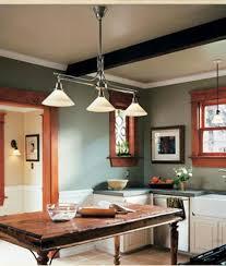 nice looking millennium lighting manchester 3 light kitchen pendant lighting over teak wooden butcher block island with white wooden kitchen set as well as