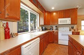 White Appliances In Kitchen Kitchen With White Appliances And Forest View Stock Photo