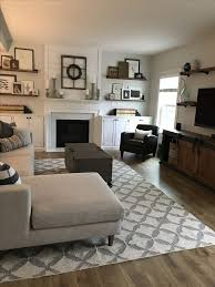 modern farmhouse living room interior define sofa west elm kilim tile rug sherwin williams frosty white shiplap floating shelves around fireplace