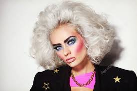 young platinum blond woman with 80s makeup stock photo