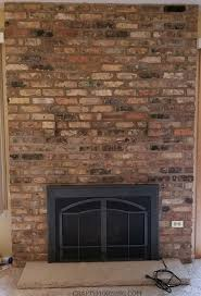 here s the brick fireplace before i started you need to dust and wipe off all the dust cobwebs it has collected before painting