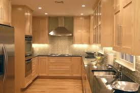 Backsplash Lighting Cool Maple Cabinets With Subway Tile Backsplash And Dark Counters Love