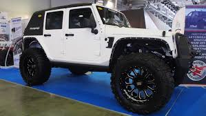 lifted 4 door jeep silver